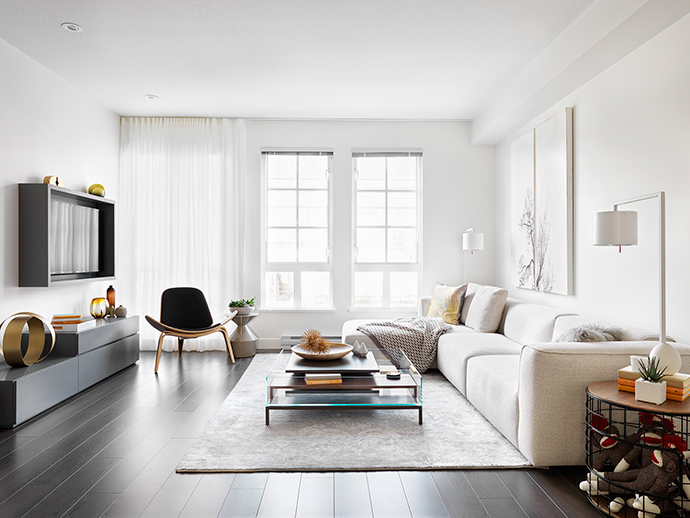 Open concept living spaces grace the Black+White floorplans.