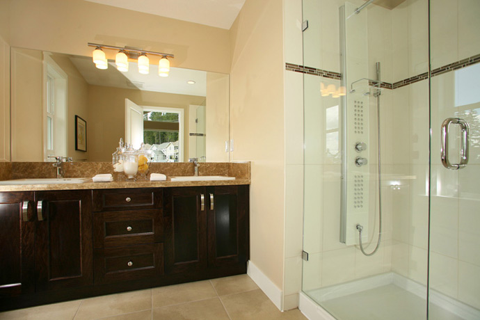 Professionally designed ensuite bathrooms with large showers and deep soaker tubs.