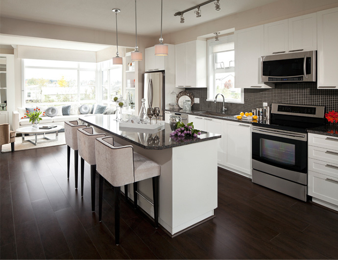 The interior kitchens at the new Adera Breeze Cirrus Collection townhouses in Surrey.
