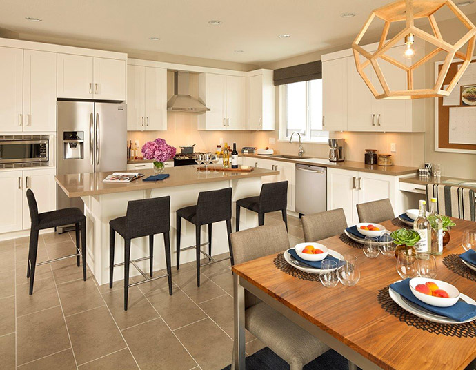 Open concept kitchens with islands and lots of counter top space here at the PoCo Citadel Heights Bluetree Homes community