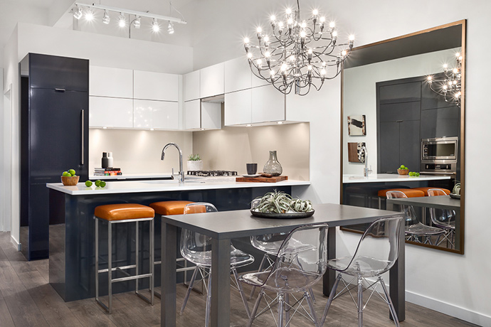 Beautiful gourmet kitchens with integrated appliances and quartz stone countertops.