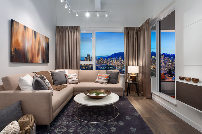 Spacious living with oversized windows allow for lots of natural light and incredible views of the city and mountains.