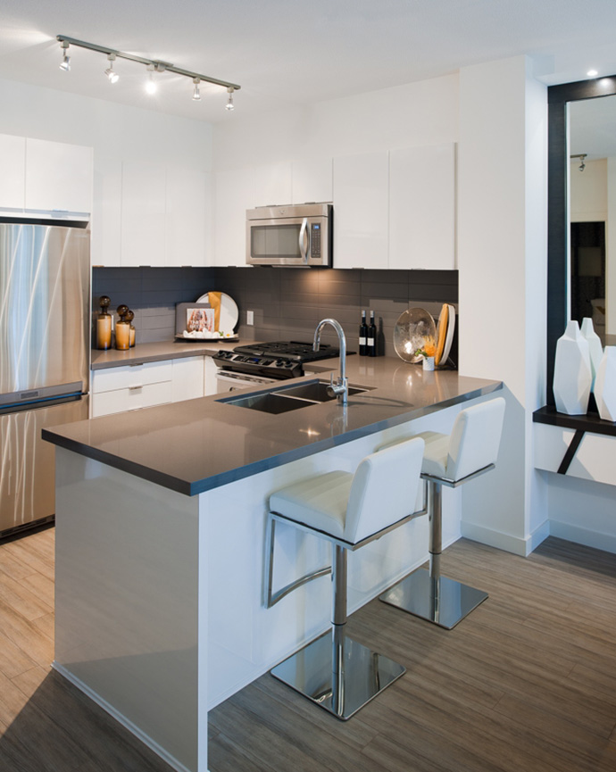 Dramatic kitchens with beautiful modern finishes grace the new Elgin House Surrey presales condos.