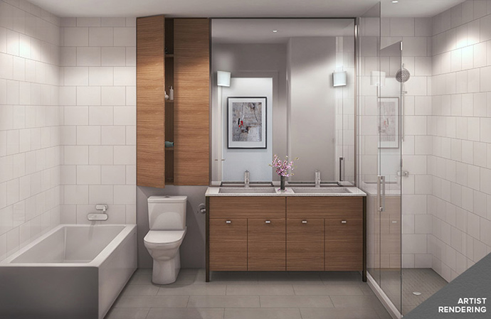 Bathrooms with double vanities and separate soaker tub from frameless glass enclosed bathroom showers.