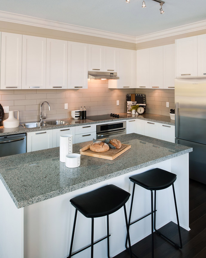 Beautiful kitchen at the executive Delta Townhomes at Sunstone Lakeside by Polygon Homes