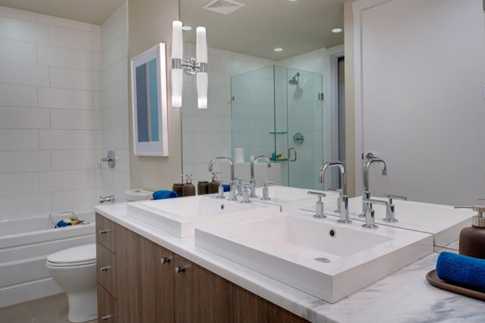 LIFT garden homes present master bathrooms with 2 vanities and separate glass enclosed walk in shower and deep soaker tubs.