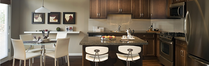 The kitchens at the strata free Langley rowhomes at Milner Heights by Vesta Properties.