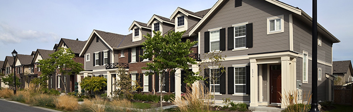 The new Langley Mantel Rowhomes with Georgian Colonial architecture.
