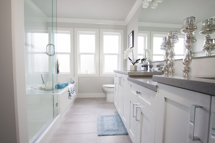 Spa inspired master ensuite bathrooms with separate glass walk in showers from soaker tub.