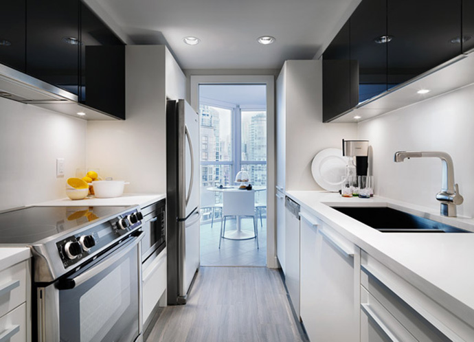 The refurbished kitchens at Pacific Point Vancouver Yaletown presale condos.