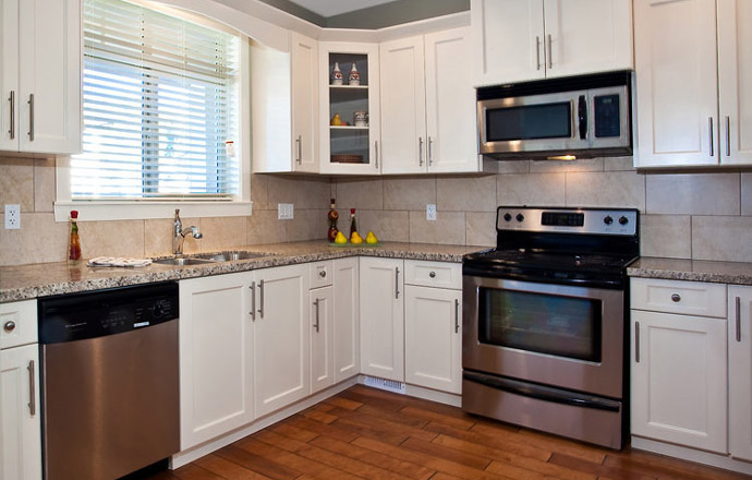 The high-end kitchen features stainless steel appliances and granite counters.