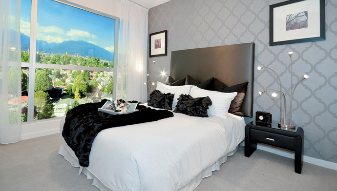 The ultimate Vancouver bedroom with gorgeous views of the city.