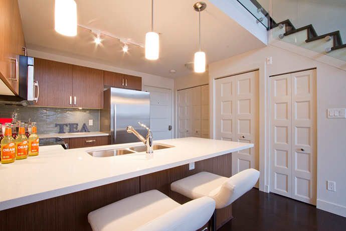 The boutique Vancouver Riley condo kitchens are superb.